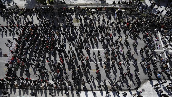 Protesters gather during a protest in Athens, Wednesday, Feb. 20, 2013. Unions have launched another general strike against austerity measures in Greece, amid predictions unemployment in the crisis-hit country will reach 30 percent this year. (AP Photo/Dimitri Messinis)