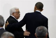 U.S. President Barack Obama (R) and Palestinian President Mahmoud Abbas leave after a news conference at the Muqata Presidential Compound in the West Bank City of Ramallah March 21, 2013. REUTERS/Larry Downing