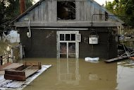 <p>A flooded house stands in the southern Russian town of Krymsk. First funerals were held in the town of Krymsk, the worst hit area in southern Krasnodar region, as emergency workers pulled more bodies from the debris and survivors insisted they had not received any flood warning.</p>