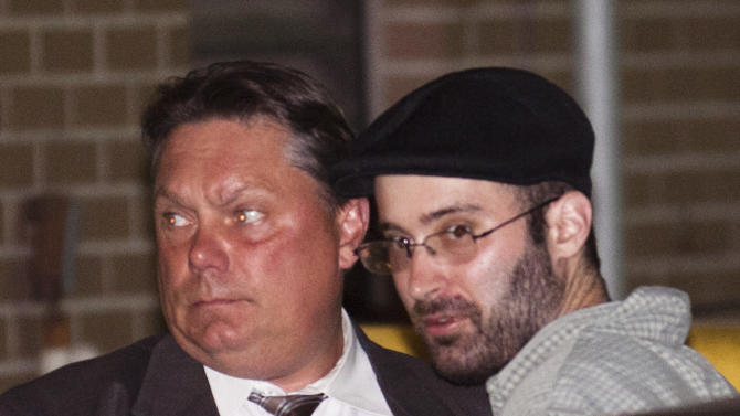 Levi Aron, right, the suspect accused killing and dismembering 8-year-old Brooklyn boy Leiby Kletzy, is led into the 67th Precinct by police, Thursday, July 14, 2011, in the Brooklyn borough of New York. Police Commissioner Raymond Kelly said the 35-year-old suspect made statements implicating himself in the boy's death. Formal charges are pending. (AP Photo/John Minchillo)