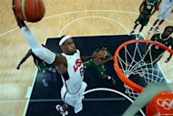 Lebron James (6) of the United States shoots against Nigeria during a men's basketball preliminary round match at the 2012 Summer Olympics on Thursday, Aug. 2, 2012, in London. (AP Photo/Christian Petersen, Pool)