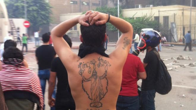 A Christian man with a Jesus tattoo on his back, Cairo.