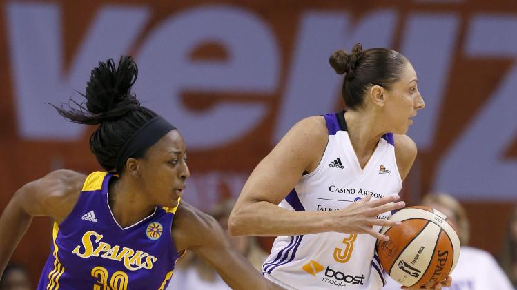 Phoenix Mercury's Diana Taurasi (3) spins away from Los Angeles Sparks' Nneka Ogwumike (30) who reaches out in vain to steal the ball during the first half in Game 1 of the WNBA basketball Western Conference semifinals Friday, Aug. 22, 2014, in Phoenix. (AP Photo/Ross D. Franklin)