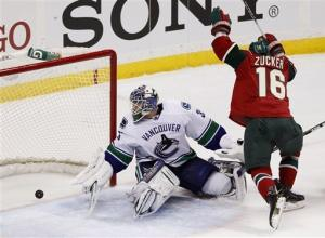 Parise scores 2 goals and Wild top Canucks 4-2