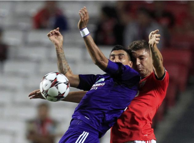 Anderlecht's Suarez and Benfica's Siqueira fight for ball during Champions League soccer match at the Luz Stadium in Lisbon
