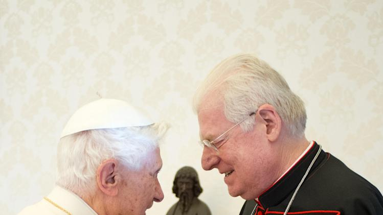 In this photo released by the Vatican paper L'Osservatore Romano, Pope Benedict XVI greets Cardinal Angelo Scola during a private audience at the Vatican, Saturday, Feb. 16, 2013. The Vatican is raising the possibility that the conclave to elect the next pope might start earlier than March 15, the earliest date possible under current rules that require a 15-20 day waiting period after the papacy becomes vacant. (AP Photo/Osservatore Romano, ho)