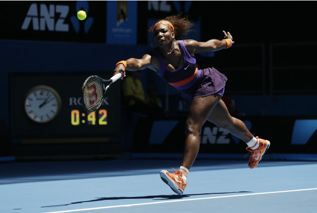 Serena Williams of the US stretches for forehand return to mRomania's Edina Gallovits-Hall during their first round match at the Australian Open tennis championship in Melbourne, Australia, Tuesday, J