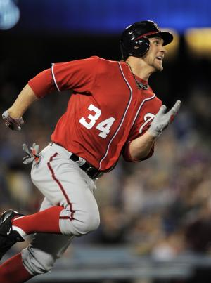 Washington Nationals' Bryce Harper rounds first after hitting a double during the seventh inning of their baseball game against the Los Angeles Dodgers, Saturday, April 28, 2012, in Los Angeles. (AP Photo/Mark J. Terrill)