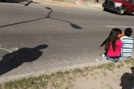 This file photo shows children sitting on the street in Juarez, Mexico, in 2010. A baby-trafficking ring aiming to pass infants on for adoption had operated for more than 20 years in Mexico and sent children to Italy as well as Ireland, according to a Mexican official