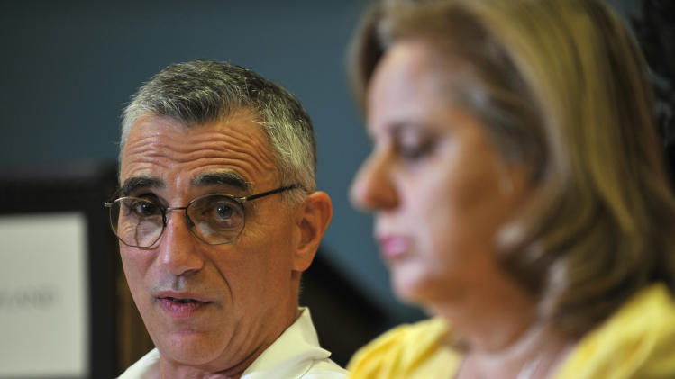 Thomas Scalea, M.D., Physician-in-Chief at the University of Maryland Shock Trauma, discusses the condition of Daniel Borowy during an interview Thursday, Aug. 30, 2012, in Baltimore. Daniel was shot while attending Perry Hall High School on Monday. Also pictured is Daniel's mother Rosemary. (AP Photo/Gail Burton)