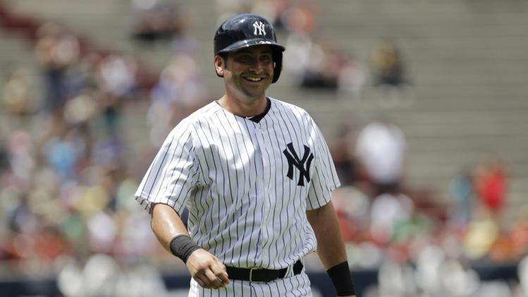 "New York Yankees' Cervelli smiles after scoring run against Miami Marlins during second inning of the exhibition game ""Legend Series"" honoring former New York Yankees player Mariano Rivera, at the Rod Carew Stadium in Panama City"