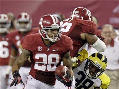 Alabama defensive back Dee Milliner (28) runs back a turnover as teammate Brandon Ivory (62) puts a block on Michigan running back Thomas Rawls (38) during the first half of an NCAA college football game at Cowboys Stadium in Arlington, Texas, Saturday, Sept. 1, 2012.  (AP Photo/LM Otero)