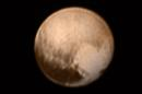 This image received on July 8, 2015 and made available by NASA/Johns Hopkins University Applied Physics Laboratory/Southwest Research Institute shows Pluto from the New Horizons' Long Range Reconnaissance Imager (LORRI) combined with lower-resolution color information from the spacecraft's Ralph instrument. (NASA/JHUAPL/SWRI via AP)