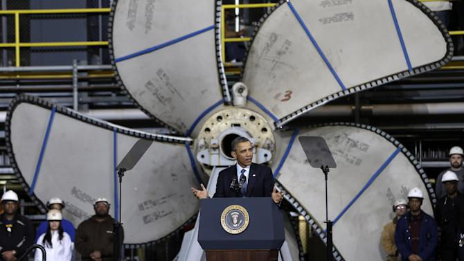 Standing in front of a ships propeller, President Barack Obama gestures as he speaks about automatic defense budget cuts, Tuesday, Feb. 26, 2013, at Newport News Shipbuilding in Newport News, Va.  (AP Photo/Steve Helber)