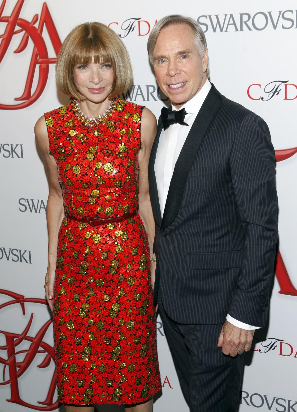 Designer Tommy Hilfiger poses with Anna Wintour backstage after winning the Geoffrey Beene Lifetime Achievement Award at the CFDA Fashion Awards on Monday, June 4, 2012 in New York. (Photo by Jason DeCrow/Invision/AP)