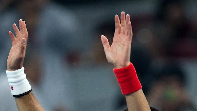 Serbia's Novak Djokovic waves to the spectators after winning the men's singles semifinal match against Florian Mayer in the China Open tennis tournament in Beijing Saturday, Oct. 6, 2012. Djokovic won 6-1, 6-4. (AP Photo/Andy Wong)