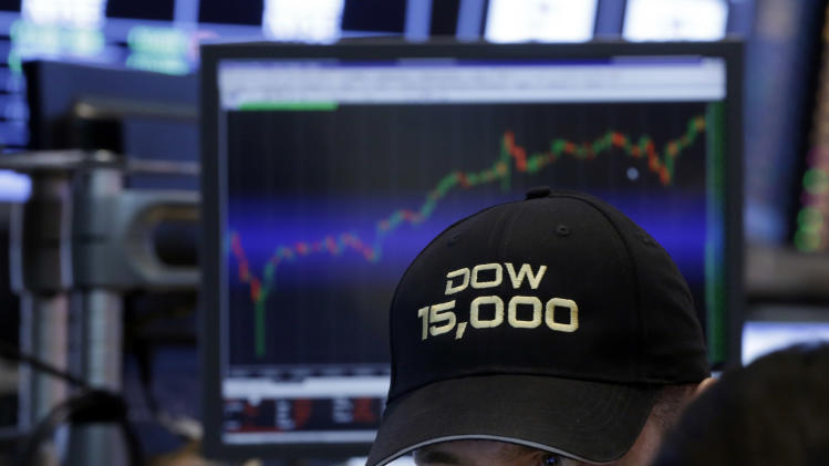 "A specialist wears a ""Dow 15,000"" hat as he works at his post on the floor of the New York Stock Exchange Friday, May 3, 2013. A big gain in the job market is lifting the stock market to a record high. The stock market surged, traders donned party hats, and the wave of buying drove three indexes through major milestones. (AP Photo/Richard Drew)"