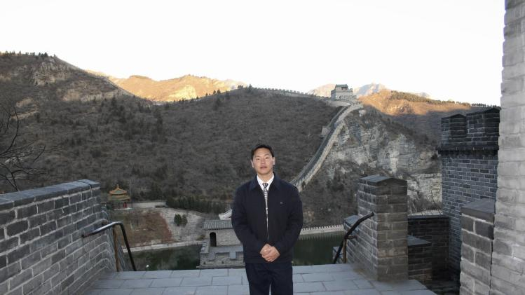 Chinese labour activist Zhang Zhiru poses for pictures at the Great Wall in Beijing