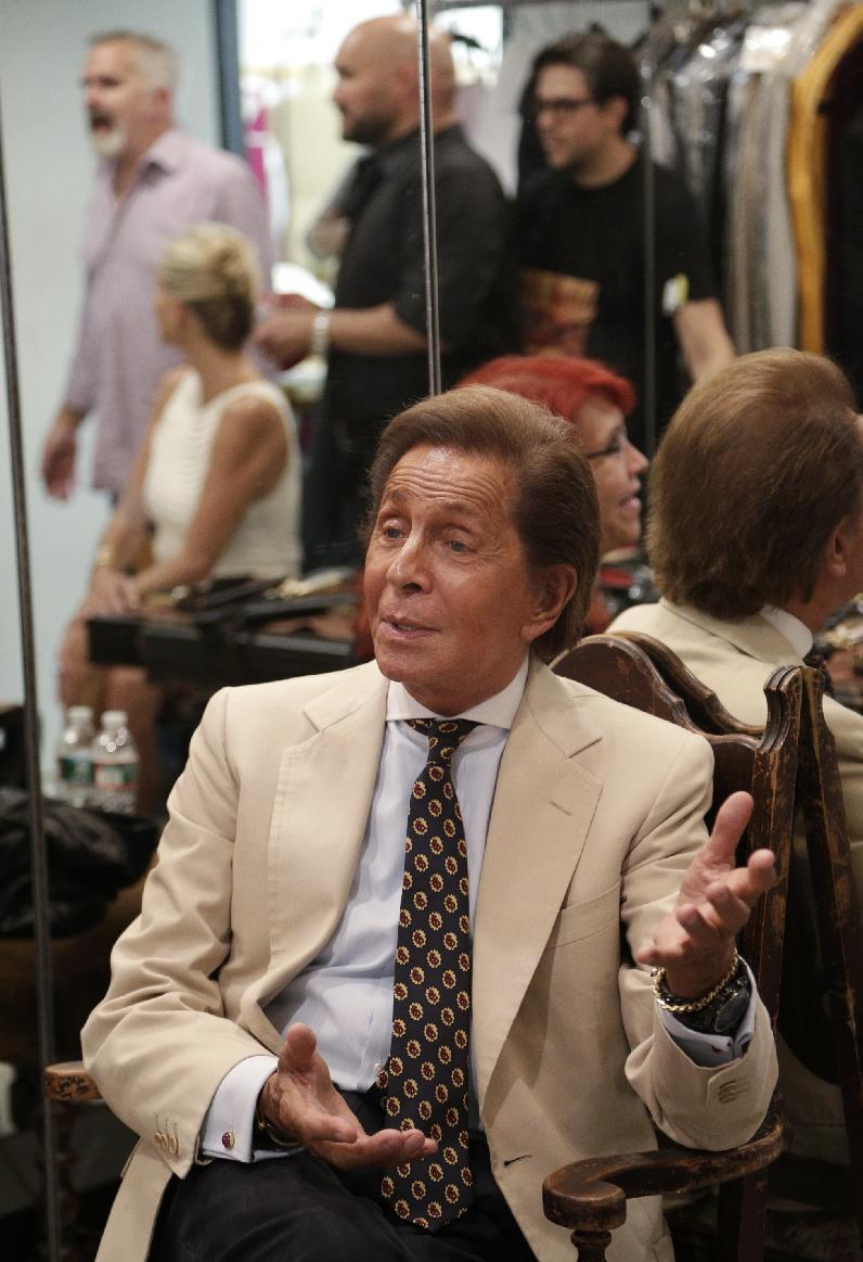 This Sept. 12, 2012 photo released by the New York City Ballet shows designer Valentino Garavani  in New York.  Valentino, 80, says he is a great fan of the ballet, and he has found designing ballet costumes has been inspiring.  (AP Photo/New York City Ballet, Paul Kolnik)