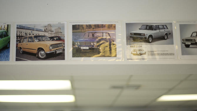 In this Feb. 12, 2013 photo, photos of the Russian made Lada car are on display in a Hialeah, Fla. auto parts store. Fabian Zakharov, a Russian man who grew up in Cuba, opened the store in Hialeah, selling parts for Russian cars in Cuba. It's a niche market, but Zakharov has sold parts for hundreds of vintage Lada and Moskvitch cars that still fill the roads of the communist island. (AP Photo/J Pat Carter)