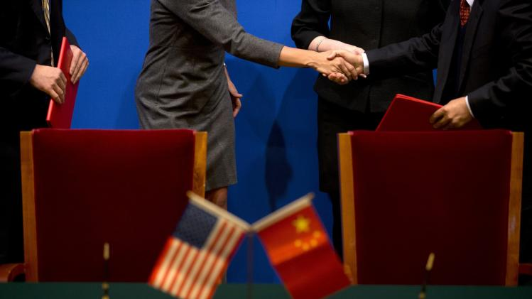 U.S. Secretary of Commerce Penny Pritzker shakes hands with a Chinese company executive at the 24th China-U.S. Joint Commission on Commerce and Trade in Beijing