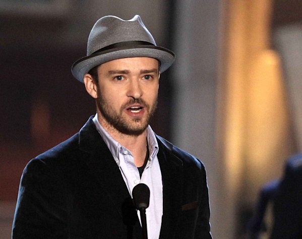 FILE - This June 2, 2012 file photo shows actor-singer Justin Timberlake accepting the troops&#39; choice for entertainer of the year award at the 2012 Guys Choice Awards in Culver City, Calif. Timberlake is apologizing for a video that shows homeless people offering congratulatory wishes to the pop star and his new bride, Jessica Biel. Timberlake posted an open letter on his website Friday, Oct. 26, saying he didnt know about the video or contribute to it in any way. He calls the video distasteful and says hes deeply sorry to anyone offended by it but acknowledges it was made by well-meaning friends. The 19-second video titled Greetings from your Hollywood friends who just couldnt make it shows three people who obviously dont know the famous couple greeting them with wedding wishes. (Photo by Matt Sayles/Invision/AP, file)