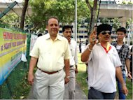 Reform Party's Kenneth Jeyaretnam arrives, flanked by supporters.