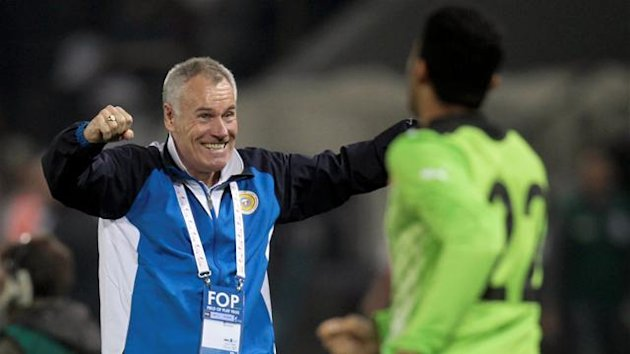 Bahrain's head coach Peter Taylor of England celebrates after his team scores during their Arab Games final soccer match against Jordan in Doha December 23, 2011.