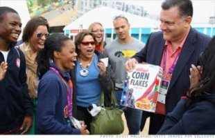 Gabby Douglas is extremely excited to see her face on a cereal box.