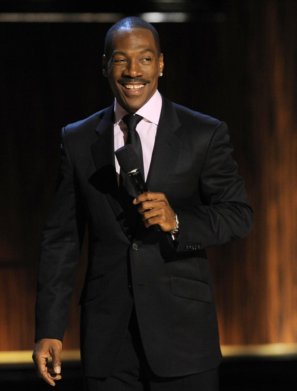 "Eddie Murphy addresses the audience at the close of  ""Eddie Murphy: One Night Only,"" a celebration of Murphy's career at the Saban Theater on Saturday, Nov. 3, 2012, in Beverly Hills, Calif. (Photo by Chris Pizzello/Invision)"