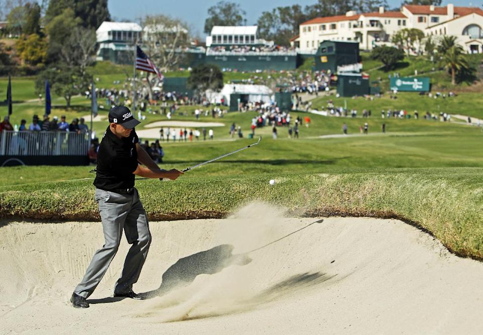 Bill Haas hits from the bunker on the 10th green in the final round of the Northern Trust Open golf tournament at Riviera Country Club in the Pacific Palisades area of Los Angeles, Sunday, Feb. 17, 2013. (AP Photo/Reed Saxon)