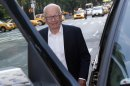 News Corp Chief Executive and Chairman Murdoch enters his vehicle as he leaves his home in New York