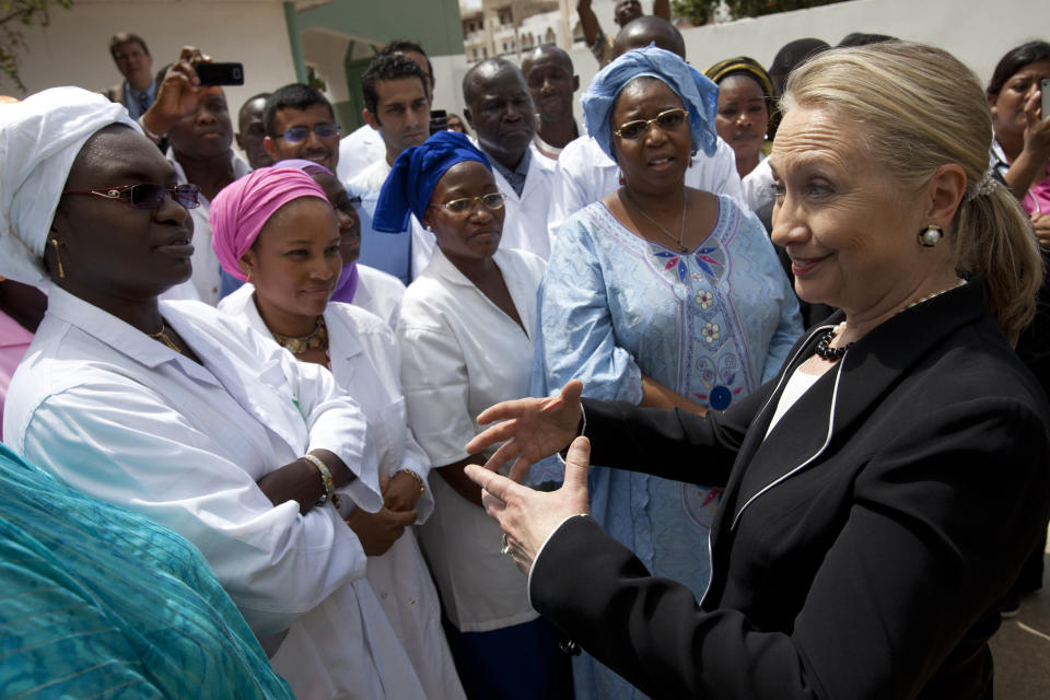 Secretary of State Hillary Rodham Clinton meets with women during a tour of the Philippe Senghor Health Center in Dakar, Senegal, Wednesday, Aug. 1, 2012. (AP Photo/Jacquelyn Martin, Pool)