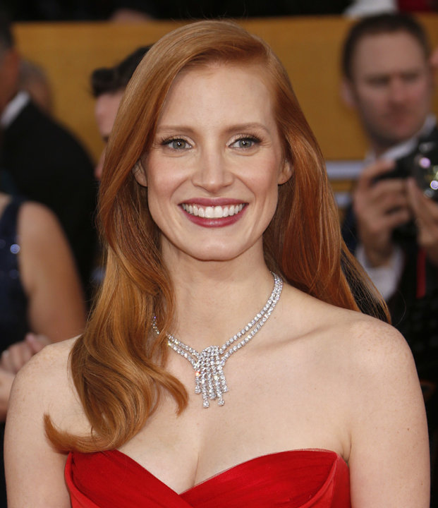 Jessica Chastain arrives at the 19th Annual Screen Actors Guild Awards at the Shrine Auditorium in Los Angeles on Sunday Jan. 27, 2013. (Photo by Todd Williamson/Invision for The Hollywood Reporter/AP