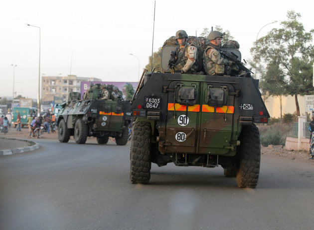 In this Jan. 15, 2013 file photo, French troops in two armored personnel carriers drive through Mali's capital Bamako on the road to Mopti. The Obama administration has declared it cannot accept n