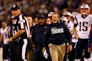 New England Patriots coach Bill Belichick (C) yells at an official during their game against the Baltimore Ravens on September 23. NFL officials said they are looking into incidents involving Belichick and Baltimore coach John Harbaugh in Baltimore's 31-30 home victory on Sunday