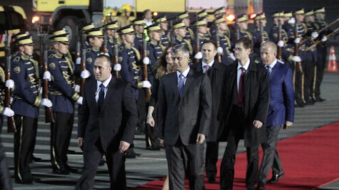 Former ethnic Albanian rebel commander and former Kosovo Prime Minister Ramush Haradinaj, left flanked by Prime Minister Hashim Thaci is welcomed by Kosovo Security Force honor guard in capital Pristina, Kosovo on Thursday, Nov. 29, 2012. A U.N. war crimes tribunal has acquitted the former prime minister of Kosovo and two of his former Kosovo Liberation Army comrades for the second time on charges murdering and torturing Serbs and their supporters in Kosovo's war for independence. ( AP Photo / Visar Kryeziu )