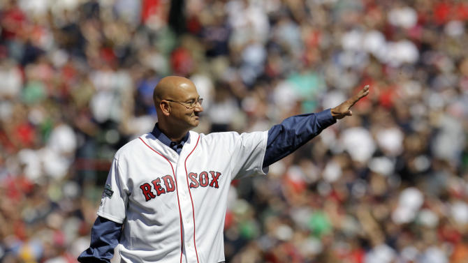 Former Boston Red Sox manager Terry Francona waves to cheering fans at Fenway Park in Boston, Friday, April 20, 2012 during a celebration of the 100th anniversary of the first regular-season game at Fenway Park,  prior to a baseball game against the New York Yankees. (AP Photo/Elise Amendola)