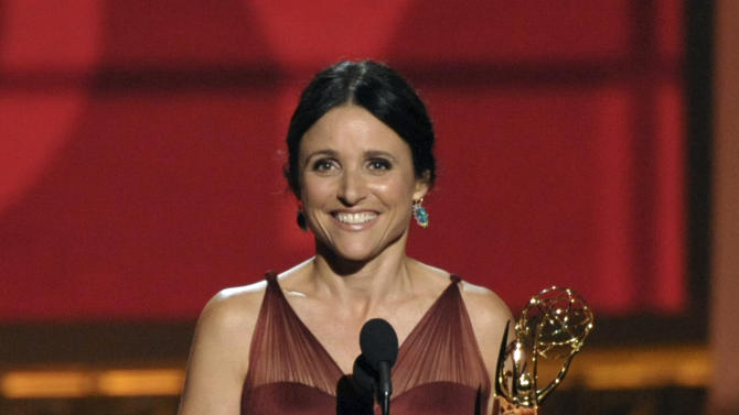 """Julia Louis-Dreyfus accepts the award for Outstanding Lead Actress in a Comedy Series for """"Veep"""" at the 64th Primetime Emmy Awards at the Nokia Theatre on Sunday, Sept. 23, 2012, in Los Angeles. (Photo by John Shearer/Invision/AP)"""