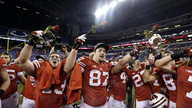 FILE - In this Saturday, Dec. 1, 2012 file photo, Wisconsin players celebrate after defeating Nebraska 70-31 to win the Big Ten championship NCAA college football game Saturday, Dec. 1, 2012, in Indianapolis. Wisconsin is heading to the Rose Bowl to face Stanford, on New Year's Day. (AP Photo/Darron Cummings, File)