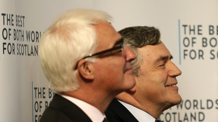 """Former British Prime Minister Gordon Brown and Alistair Darling, the leader of the campaign to keep Scotland part of the United Kingdom, applaud before speaking at a """"Better Together"""" rally in Dundee, Scotland"""
