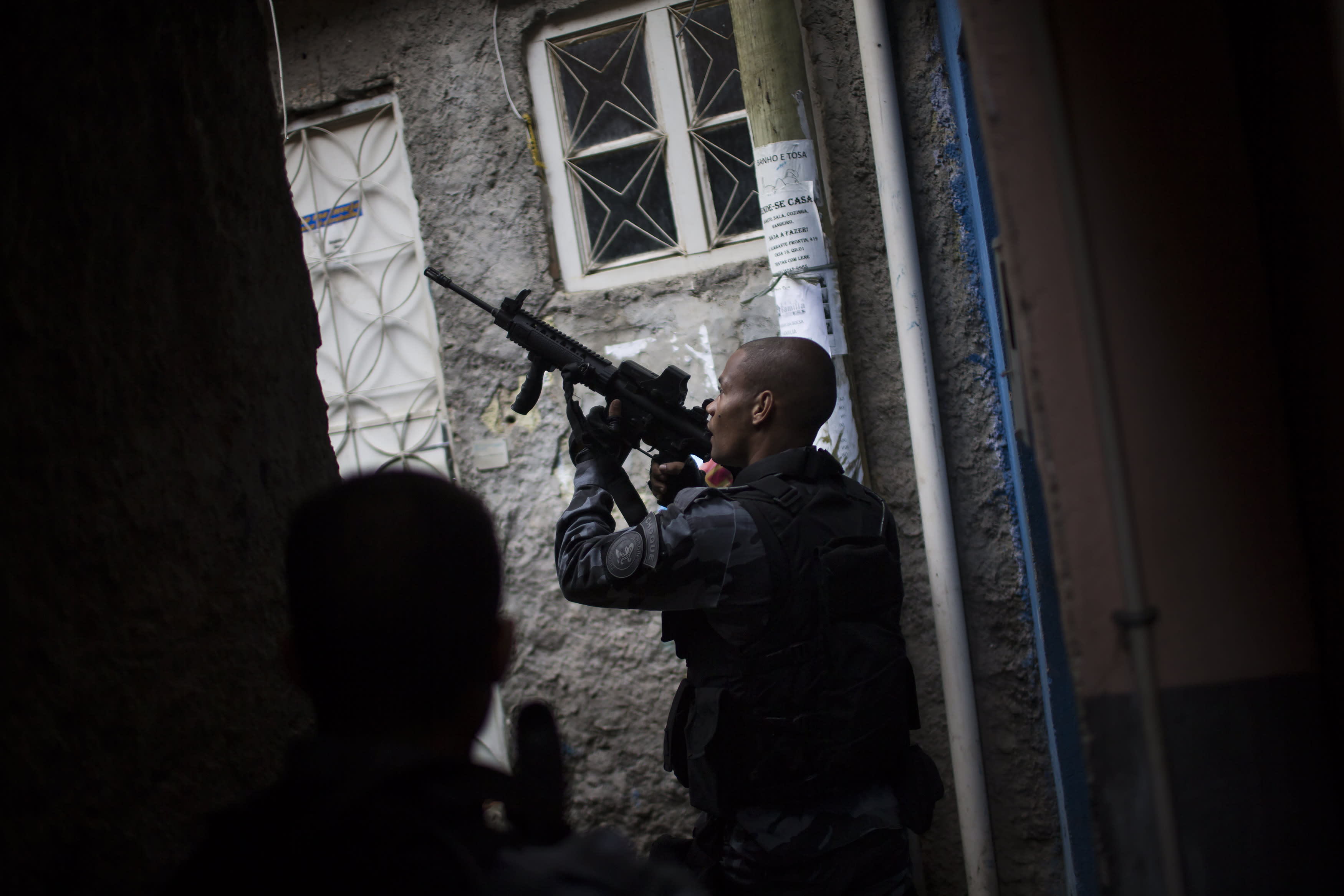 Police move into violent Rio slum, taking over from army