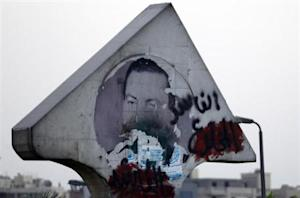 "A defaced picture of former Egyptian President Hosni Mubarak with graffiti that reads, ""Corrupt and deposed"" along a highway in Cairo August 21, 2013. REUTERS/Amr Abdallah Dalsh"