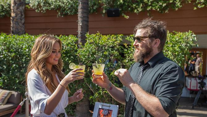 IMAGE DISTRIBUTED FOR CAPTAIN MORGAN - In this image released on Friday, May 22, 2015, Chrissy Teigen enjoys a cocktail featuring the new CAPTAIN MORGAN® Pineapple, Coconut and Grapefruit Rums with local mixologist Joe Brooke at the Hollywood Roosevelt Hotel in Los Angeles, CA. (Jeff Lewis/ AP Images for Captain Morgan)