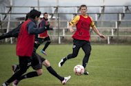 Maxim Molokoedov (R) takes part in a training session with Chilean second division football team, Santiago Morning. He said that playing on the Chilean team has helped him turn his life around