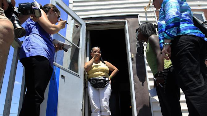 Norma Hernandez answers a question as she stands in the doorway of her home in Camden, N.J., Tuesday, May 29, 2012. Hernandez says that she went to police in the 1980s with concerns that her brother Pedro Hernandez may have killed someone, but the police never followed-up with her. Pedro Hernandez confessed last week to the killing of 6-year-old Etan Patz in 1979, and is now charged with his murder. (AP Photo/Mel Evans)