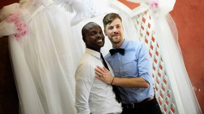 Willie Phearson and Gregory Locklear pose after their wedding ceremony on July 1 in West Hollywood.