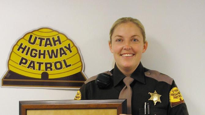 FILE - Utah Highway Patrol Officer Lisa Steed holds her award after being named Trooper of the Year in this undated file photo provided by the Utah Highway Patrol on Nov. 11, 2007. Once a rising star in the ranks of the Utah Highway Patrol, Steed has taken a stunning fall from grace based on allegations that she booked dozens of people for DUIs when they hadn't been drinking at all. (AP Photo/Standard-Examiner, Utah Highway Patrol)