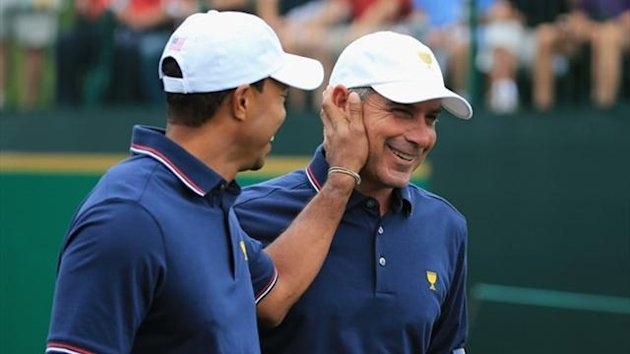Tiger Woods of the U.S. Team greets his Captain Fred Couples at the Presidents Cup (AFP)
