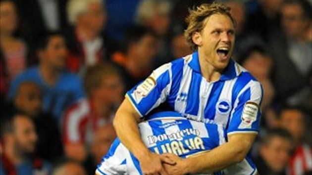 Brighton and Hove Albion's Craig Mackail-Smith (top) celebrates (PA)